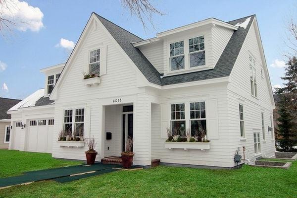 Graues Dach und grüne Flächen für ein modernes weißes Haus Design