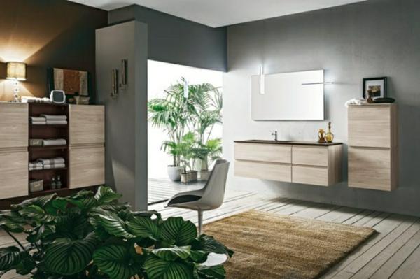 wohnzimmer modern einrichten - grüne pflanzen und braune möbel