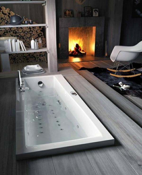 Zimmer mit eleganter Badewanne und luxus Feuerstelle
