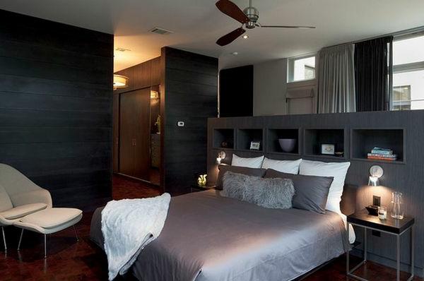 Farbtönung in Schwarz und schönes Regalsystem im Schlafzimmer