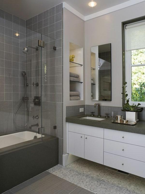 baddesign mit grauen fliesen und einer duschkabine