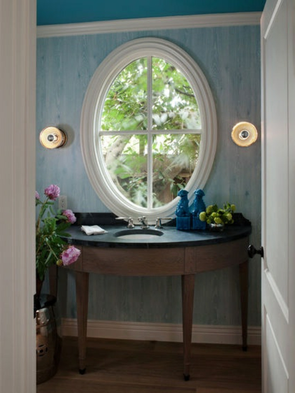 wandgestaltung in hell blau - rundes spiegel