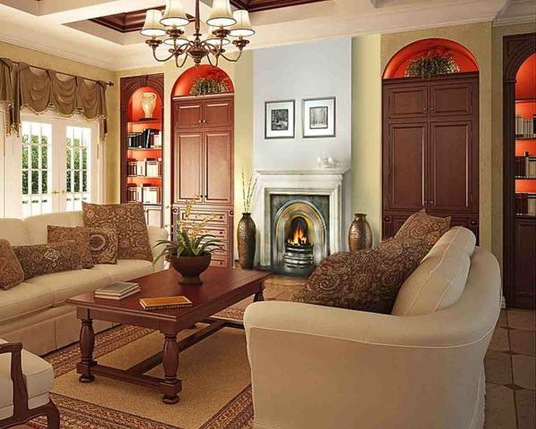 wohnzimmer einrichtung mit zwei sofas in weiß und einem kamin