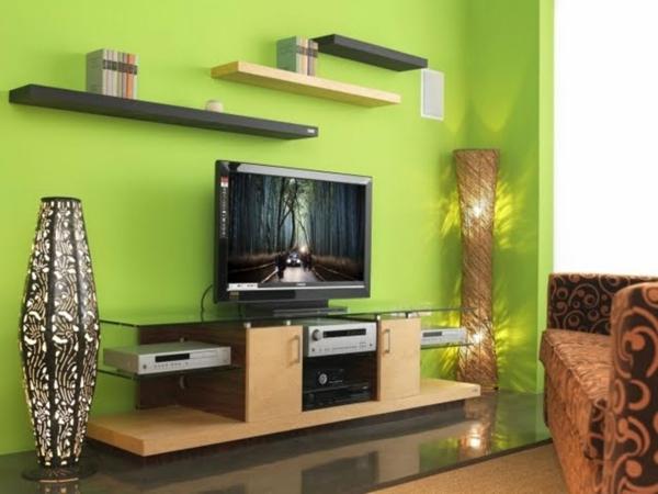 luxus lampe fernseher und grüne wandfarbe im wohnzimmer