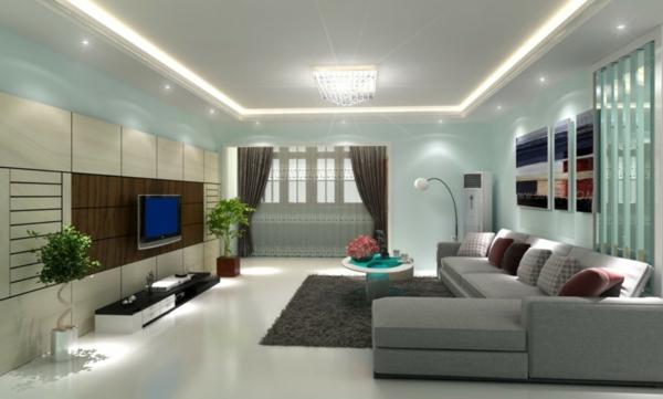 gute beleuchtung im großen wohnzimmer mit blauer wandfarbe