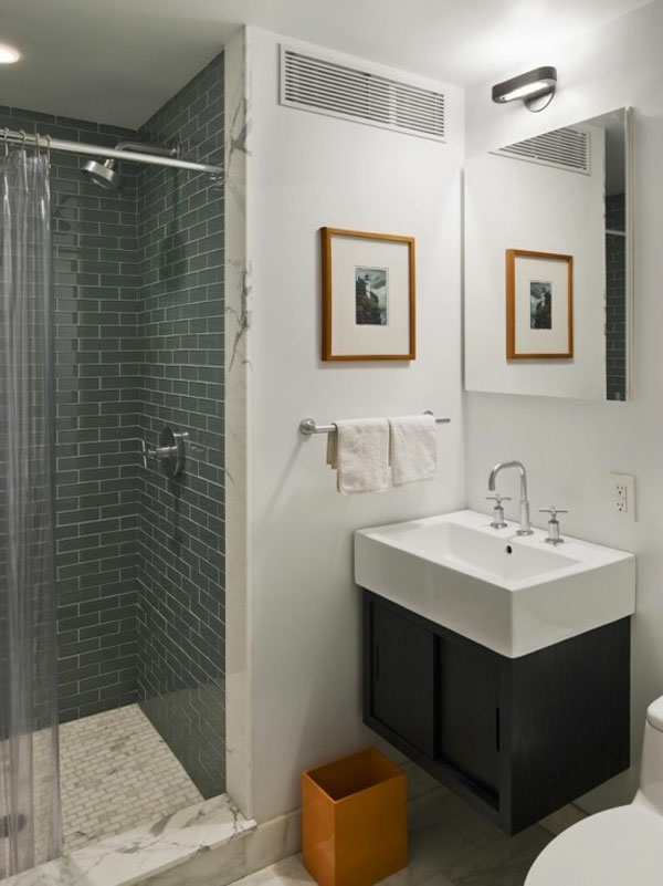 badezimmer design mit  graunen fliesen und bild mit rahmen