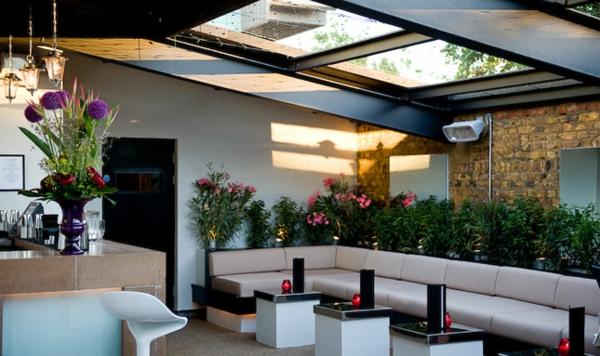 terrasse design mit einem dach aus Glas