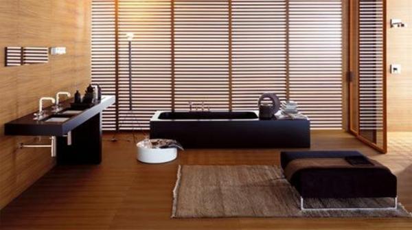 baddeisgn mit luxus badewanne und schwarze bademöbeln