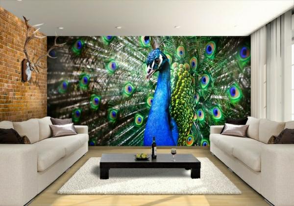 weißes sofas, dunkel brauner nesttisch und eine kreative wandgestaltung - pfau bemalung