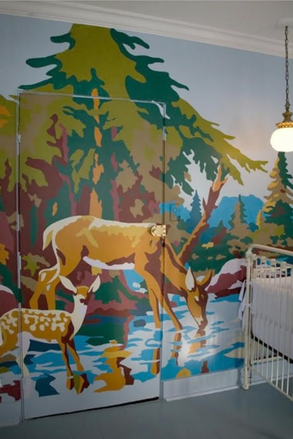 babyzimmer mit riesiger bemalung - kreative wandgestaltung ideen