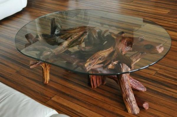 gläserner nesstisch mit beinen aus treibholz - deko fürs wohnzimmer