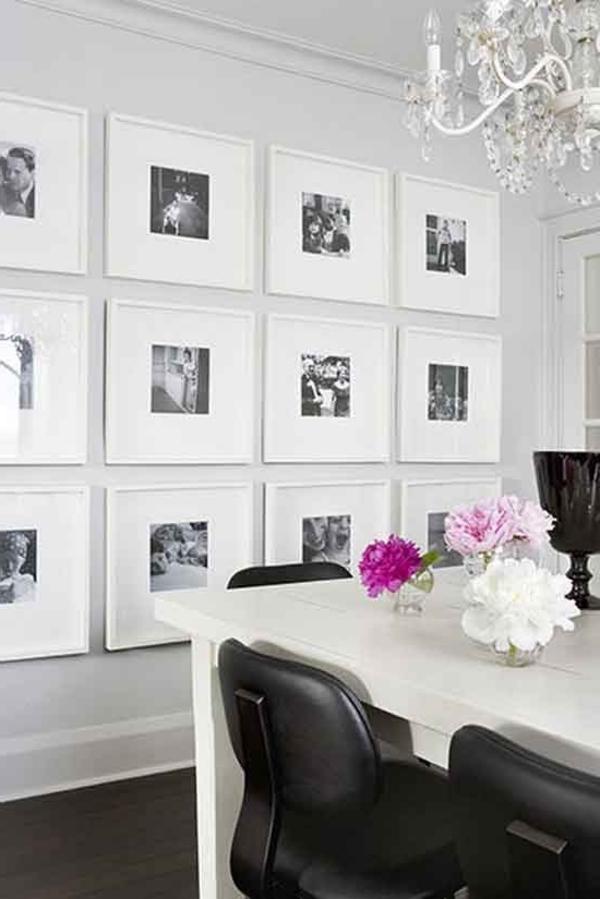 bilder und fotos an der weißen wand im esszimmer - dekoidee für elegante gestaltung