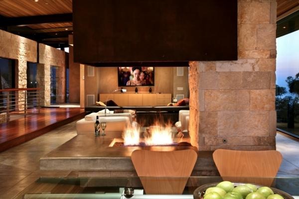 kamin aus stein im modernen wohnzimmer
