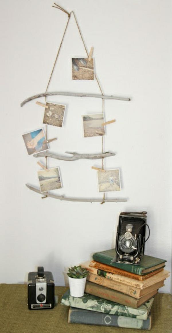 fotos auf treibholz stöcke hängen