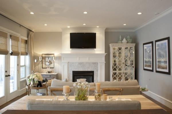 wohnzimmer mit wandgestaltung in grau une einem luxus kamin