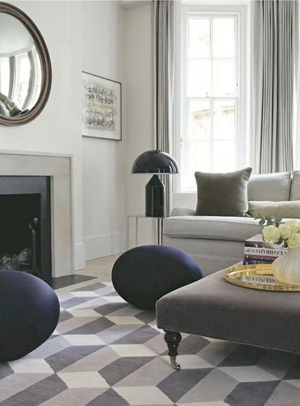 Modernes Wohnzimmer Gestaltung im grau mit Ottomane