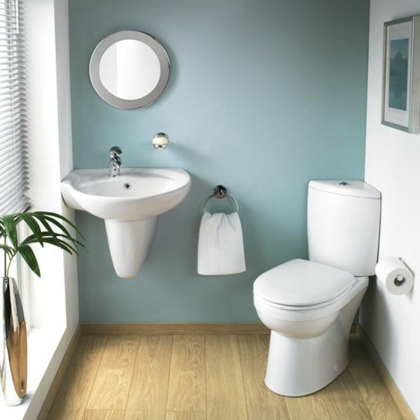 badezimmer- weiß-und-grau - mit einer grünen pflanze