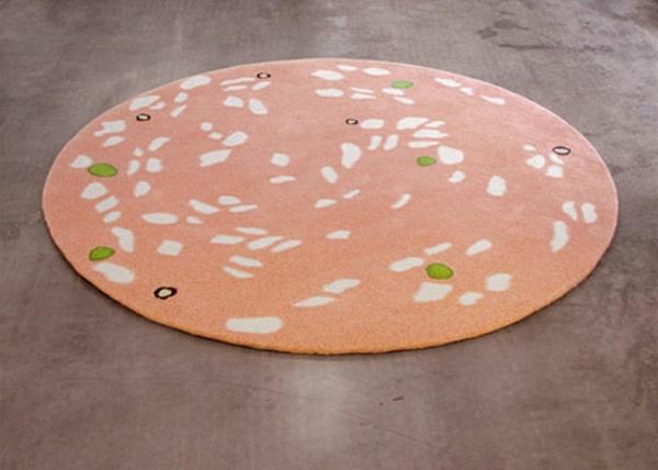 designer-teppich-runde-form-pfirsich-farbe- schön wirken