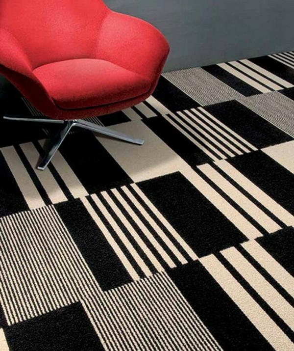 designer-teppiche-weiß-und-schwarz- mit einem roten sessel