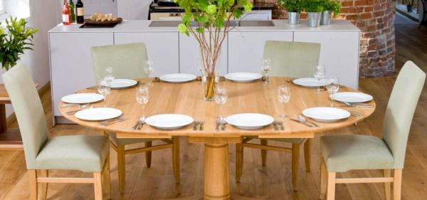 ovalförmiger-ausziehbarer-esstisch-aus-massivholz- teller in weiß - aus Porzellan