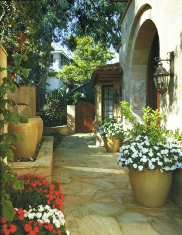 topfpflanzen-im-mediterannen-garten- stein und pflanzen