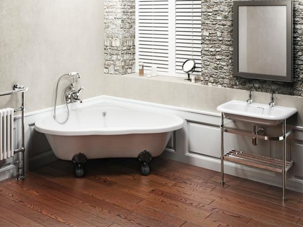 weiße-freistehende-badewanne-in-der-ecke - im badezimmer mit stein strukturen an der wand