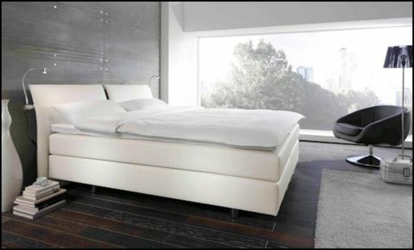 weißes-boxspringbett im eleganten schlafzimmer