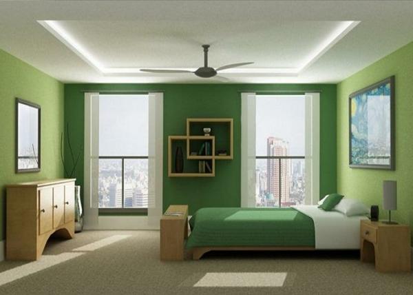 farbgestaltung-schlafzimmer-grüne-wände-schönes-bett - bilder an der wand
