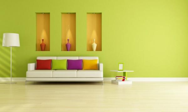 farbgestaltung-wohnzimmer-grüne-farbschemen - lampe und nesttisch