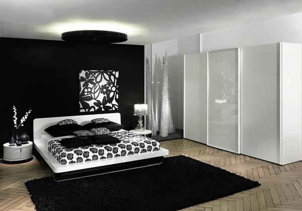 farbideen-schlafzimmer-schwarz-und-weiß-gestaltet- weiße schränke und interessante beleuchtung
