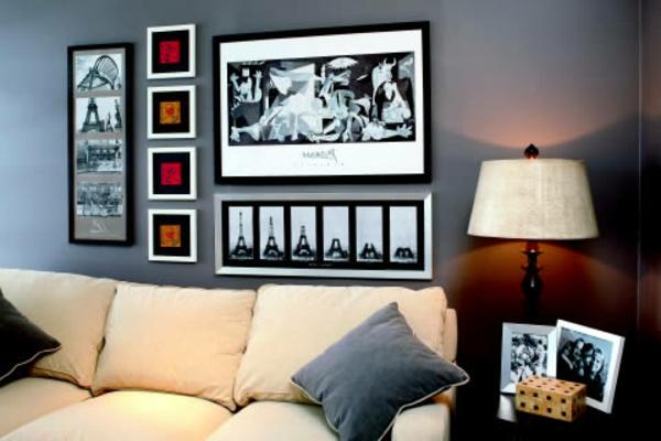 graut ne wandfarbe wohnzimmer mit bildern an der wand dekokissen auf dem sofa. Black Bedroom Furniture Sets. Home Design Ideas
