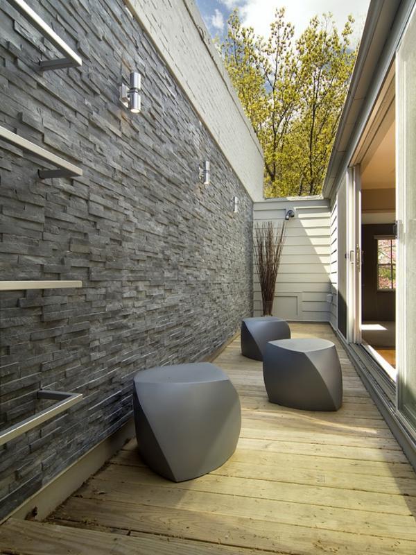 kleiner-garten-boden - wand aus grauen steinen