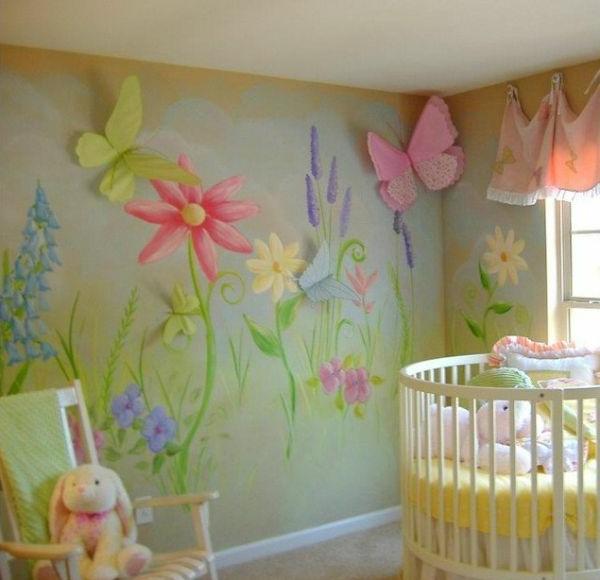 kleines-babyzimmer-mit-einem-runden-babybett-und-wunderschöner-wandgestaltung- blumenfiguren