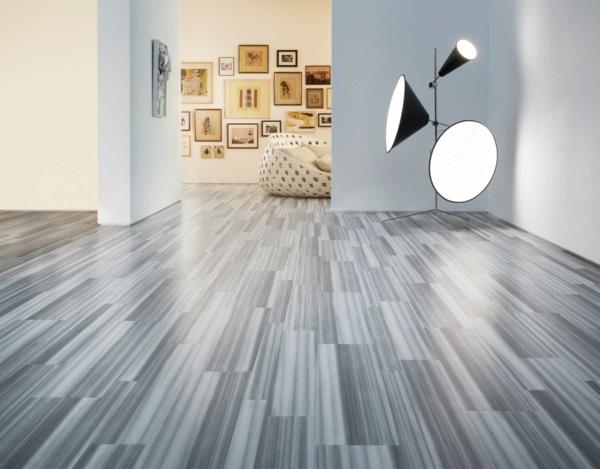 moderne-bodenbeläge-graue-farbe - viele bilder an der wand