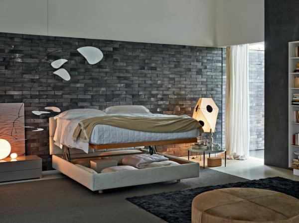 modernes-schlafzimmer-mit-einem-schönen-bett - wand aus ziegeln