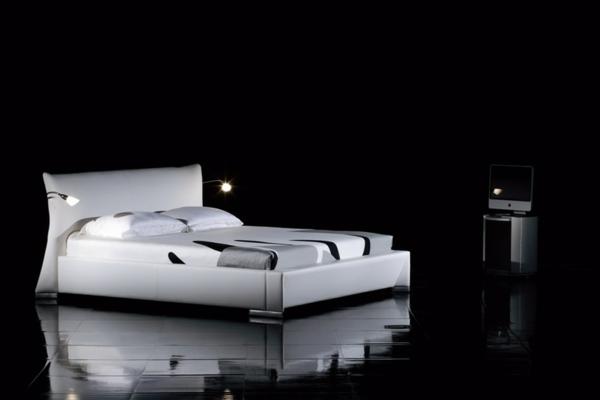 modernes-weißes-wasserbett-schwarzer-hintergrund - elegant