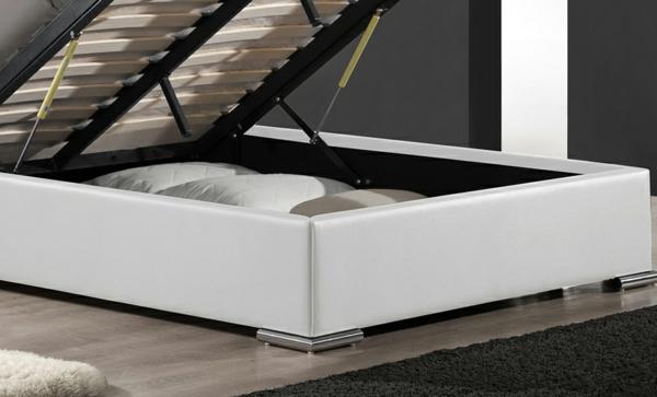 schlafzimmer-mit-einem-weißen-bett-mit-kasten - modern
