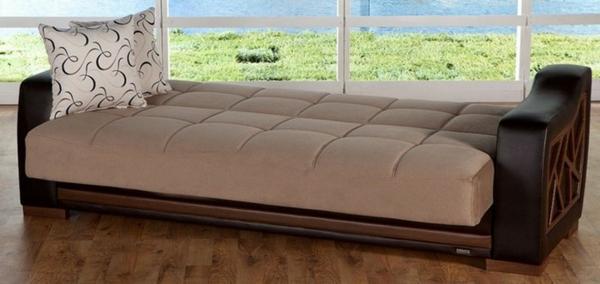 sofa-günstig-onleine-kaufen-ikea - wand aus glas und dekorative kissen