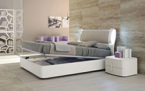 weißes-bett-mit-bettkasten-im-schönen-schlafzimmer - neue gestaltung