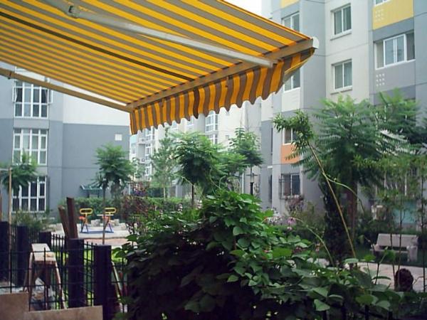 gelbes-sonnensegel-für-terrasse-eine verblüffende idee