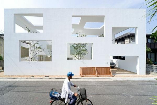 moderne-idee-für-minimalistische-architektur-man mit fahrrad