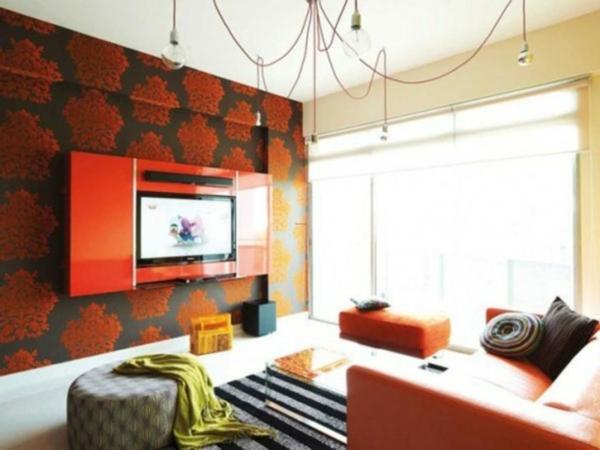 wohnzimmer rote wand:Wohnzimmer mit rote Sofa und schwarz-rote Wand.
