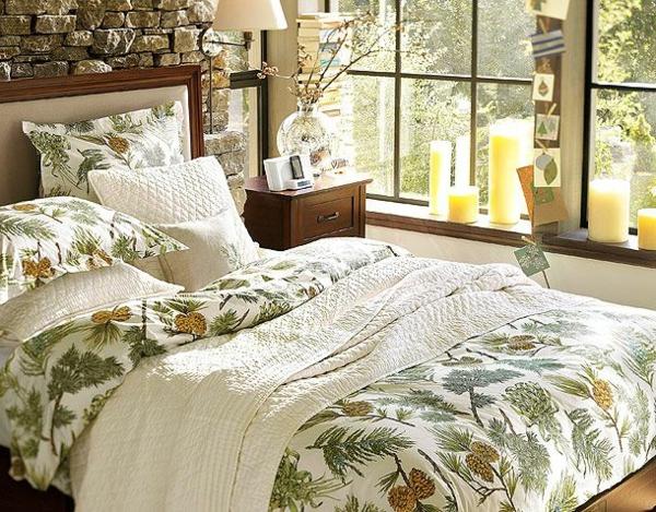 elegantes-schlafzimmer-bettwäsche-mit-ornamenten-gläserne wand