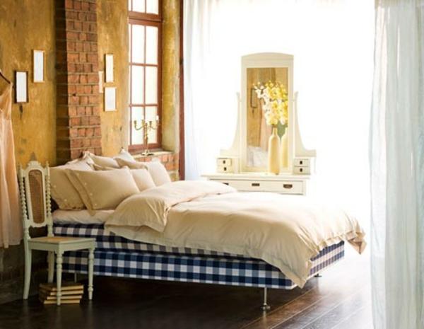 gemütliches-schlafzimmer-nordische-möbel-ziegelakzent an der wand