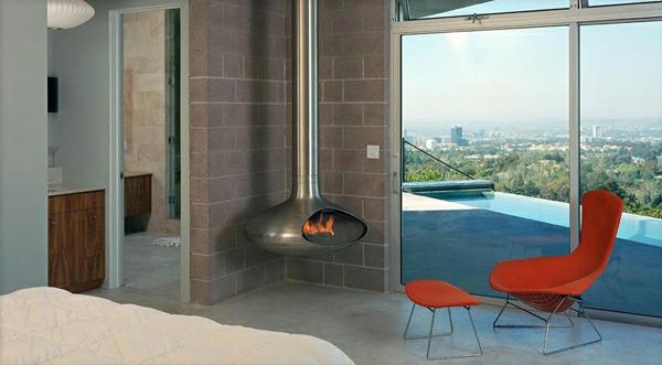 hängender-kaminofen-mit-einem-eleganten-look-schlafzimmer mit einer glaswand