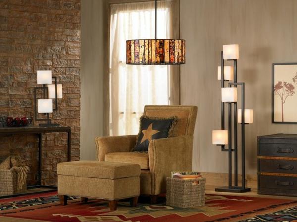ziegelwand wohnzimmer:kleines-wohnzimmer-mit-schönen-lampen-eine ziegelwand und ein kissen
