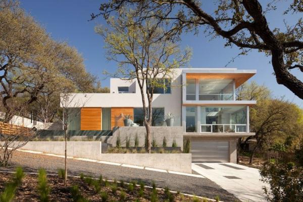 moderne-fassade-für-häuser-orange-elemente- und weiße hauptfarbe