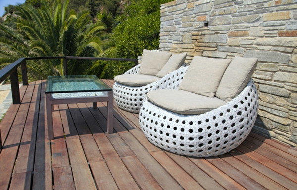 White outdoor furniture on wood resort terrace