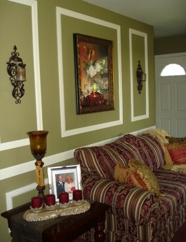 wandfarbe-olivgrün-für-ein-schönes-zimmer- dekokissen auf dem sofa