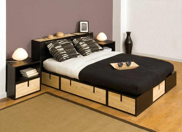 elegantes-doppelbett-mit-einer-nachtlampe-in-schwarz